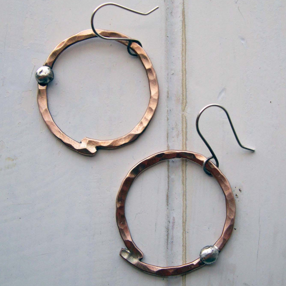 Hammered bronze hoops with sterling accent.